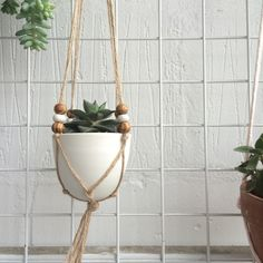 Burgeoning hanging planter obsession alert! This one has wooden beads. Bambino ceramic planter with macrame £21.00