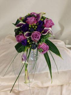 Modern cascade bridal bouquet in purple and green tones. Designed by Rebekah at Ballard Blossom, Seattle Wedding Flowers, Seattle Florist.