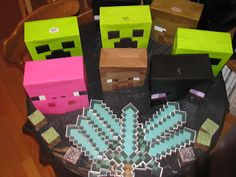 DIY Minecraft character heads (made out of dollar store gift bags). Pig, Creeper, Steve, Hero Brine, and Enderman heads.
