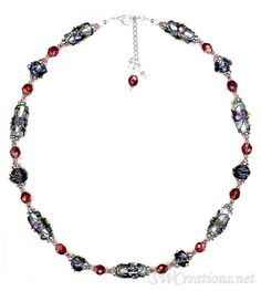 Adjustable 22 - 23 inch beaded necklace created with light rose Swarovski Austrian crystals, blue lampwork glass beads, ruby pink Czech glass beads, Bali .925 silver, sterling silver, and a sterling s