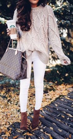 Oatmeal knit sweater with white jeans.