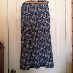 C&B Navy Blue Floral Skirt Putty, blue, gray blue flowers on navy. A line maxi skirt. Side zipper. Button waist band with elastic side panels for a perfect fit. 100% polyester. Easy care. Size 6. Christopher & Banks. Very gently used. Christopher & Banks Skirts Maxi