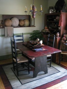 FARMHOUSE – INTERIOR – vintage early american farmhouse showcases raised panel walls, barn wood floor, exposed beamed ceiling, and a simple style for moulding and trim, like in this farmhouse dining room. Primitive Dining Rooms, Primitive Kitchen, Primitive Furniture, Primitive Antiques, Country Primitive, Country Kitchen, Primitive Decor, Country Living, Primitive Hutch