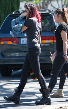 Bold: Jacksonlooked effortlessly cool in a charcoal T-shirt teamed with bottoms and leather boots