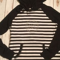 Michael Kors Hooded Shirt Brand New! Adorable Hooded shirt, with front hand pocket and a nice long length.  Super Comfy and still will look great to wear out! MICHAEL Michael Kors Tops Sweatshirts & Hoodies