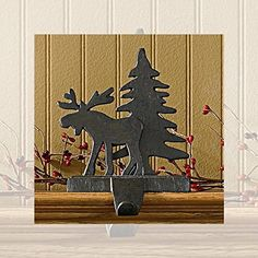 Park Designs Moose and Tree Stocking Holder - Iron Finish, http://www.amazon.com/dp/B005JA2MM0/ref=cm_sw_r_pi_awdm_GS9wwb1D3WWV5
