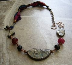 Ancient Secrets necklace with raku beads and silk by lejonklou, $49.00