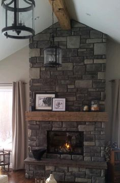 Barn beam mantel, stone fireplace.  I want my future home to look exactly like this...