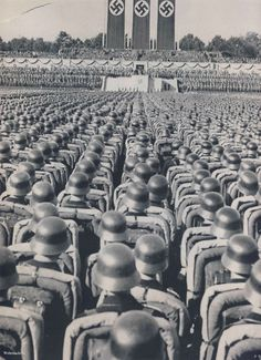 Thousands of German soldiers listening to a speech by Adolph Hitler, mid 1930s Nuremberg.