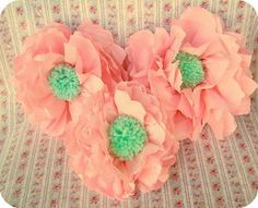 Paper napkin anemones with yarn pom poms! tutorial found at: http://www.dana-made-it.com/2008/07/tutorial-wallflowers.html