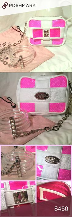 """Tarina Tarantino neon pink bracelet clutch Used once/ flawless inside💕out- like new condition. Comes in pink TT dust bag which is a little worn from storage. Limited edition small neon pink vinyl and mwhite leather clutch features a large Swarovski crystal bow which doubles as a hand strap. A detachable 10.75"""" long chain connects it to a set of clear lucite bangles held in place with a crystal-studded metal bar slider. Bag measures approximately 5.75"""" wide, 4.25"""" tall, and 1.75"""" deep. You…"""