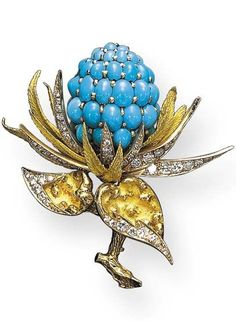 A TURQUOISE, DIAMOND AND GOLD THISTLE BROOCH, BY CHAUMET Centering on a cabochon turquoise pistil extending textured gold and circular-cut diamond leaves, on a textured gold branch, mounted in 18K gold, with French assay marks and maker's mark Signed Chaumet, Paris