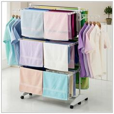 Make the best use of an indoor clothes drying rack - Designalls Laundry Hanger, Drying Rack Laundry, Indoor Clothes Drying Rack, Outdoor Clothes Lines, Garage Door Insulation Kit, Laundry Room Layouts, Folding Laundry, Garment Racks, Cupboard Design