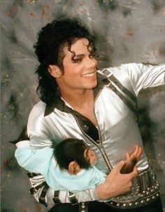 Great picture of him and Bubbles :)  Love MJ's smile. (and it doesn't hurt he is in my favorite tour outfit either lol)