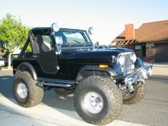 Jeep cj5 black big mud tires! Great car to play with