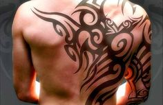 A tribal tattoo is full of movement and flow, the whole tattoo is crafted in such a way it suits the wearer as a second skin outlining his back and arm.