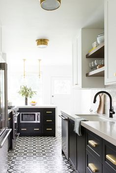 Patterned cement tile and two toned cabinets in a small bright kitchen
