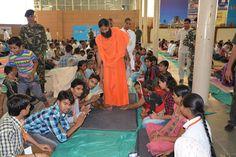 people Taking blessings of #Yoga guru  swami Ramdev at #Yuva Shivir #Patanjali Yogpeeth, #Haridwar