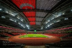 National Stadium by TimothyTan. Singapore Indoor Stadium during join qualifying for 2018 FIFA WORLD CUP RUSSIA - ASIAN & 2019 AFC ASIAN CUP  match  The 55000 capacity National Stadium has a retractable seating capability making it the only stadium in the world able to host a multitude of events such as rugby cricket football athletics concerts family entertainment shows national and community events.