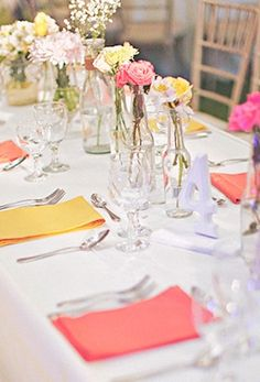 The white with pops of pink, orange and yellow is so modern and fun! From Bride and Breakfast