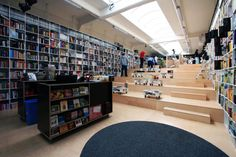 Image 4 of 20 from gallery of Bookshop And Coffee Bar / Plural + Totalstudio. Courtesy of Plural, Totalstudio Photo Grid, Layout, Construction, Dezeen, Retail Design, Online Shopping Clothes, Coffee Shop, Gallery, House