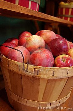 A wooden basket of fresh picked apples in Autumn