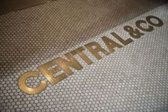brass word inlay in floor - Google Search