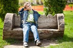 Cute kid sitting on bench Royalty Free Stock Images