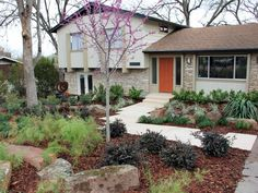 Curb Appeal Makeovers - 15 Before and After Photos | HGTV  Love the mulched yard, no mowing.