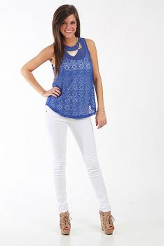 """Now You See Me Tank, Royal $34.50  We love this top! All of the tiny cutouts give this an almost lace-like appearance which is right on trend this season. Plus, did you see the exposed zipper on the back? Slip this over a bandeau and jeans for a great look!   Fits true to size. Miranda is wearing a small.   From shoulder to hem:  Small - 23""""  Medium - 24""""  Large - 25"""""""