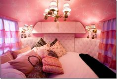 Pink teardrop trailer!  Although it is seriously cute, I'd change the color scheme to browns, bronzes and golds to avoid the pepto bismol overload.