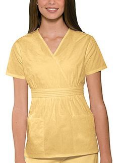 "Empire Waist Top in Dandelion A cute all-over circle motif embroidery enhances this mock wrap top which features beautiful pin tucked waistband, empire waist, two front patch pockets, side vents and fashionable back smocking for a flattering fit. Center back length: 25 1/2"".  Fabric: Cotton/Poly  $27.99 #scrubs #nurses #doctors #medicaloutlet #studio #cherokee"