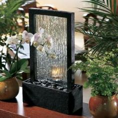 Bring the beauty and serenity of a tropical waterfall indoors with this cascading fountain. Water gently washes over the river rocks, creating a calm, peaceful setting.