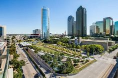Klyde Warren Park serves as a central gathering space for Dallas and its visitors. The deck park, designed by The Office of James Burnett, is an urban green space built over the recessed Woodall Rodgers Freeway between Pearl and St. Plan Maestro, Dallas Real Estate, Urban Park, Sky View, Texas Travel, Commercial Real Estate, Contemporary Landscape, Best Cities, Park City