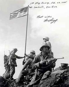 This vintage photo features the first American flag raising during the Battle Of Iwo Jima on Mount Suribachi. Celebrate WWII History with this digitally restored vintage poster from The War Is Hell Store. Us Marines, Marine Corps, Batalha De Iwo Jima, Iwo Jima Flag, First American Flag, Battle Of Iwo Jima, Military History, Military Photos, Black White