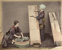 "[Two Japanese Women Posing with Laundry]. Date: 1870s.  ""Washing and Ironing"""