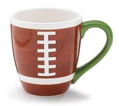"""Handwash only/FDA approved. Hand-painted ceramic mug with brown and white stitching on the front to resemble a football. Interior is white and handle is green. 4 1/2""""H X 3 1/4""""Opening Holds: 14oz."""