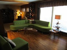 Retro Living room with curvy green couch