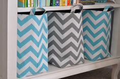 Container Store chevron baskets. Playroom organization
