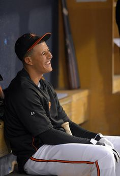Manny Machado shares a light moment on the bench before his first minor league rehab assignment for High-A Frederick.