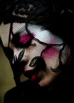 """ the lace scarred her face of makeup so deep and dark cerise """