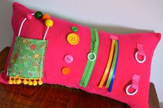 Memory Lane Sewing.  Pink activity pillow for those with Alzheimer's Disease.