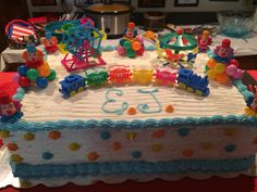 Circus themed cake with baby's initials.