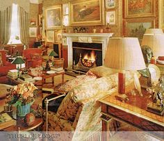 Gorgeous room, fabulous art, lots of red and yellow.........Thurloe Lodge, home of Mayfair club owner Mark Birley. This image appeared in the Telegraph Magazine. Mark was a friend of Geoffrey Bennison who sold him many antiques, paintings and objets from his shop in Pimlico Road and supplied the sofa covered in roses.