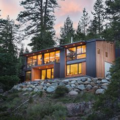 California-based Studio Bergtraun has completed a holiday home in Tahoe, nestling a simple black volume clad in corrugated metal into the steep landscape.