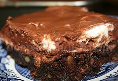 Mississippi Mud Bars, made with a brownie layer and topped with marshmallows, returned to the oven long enough to melt, and finished with a powdered sugar, chocolate frosting.