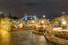 Instagrammers save the date! Coppa Club's Thames-side PVC igloos at Tower Bridge are back and more magical than ever. Back in 2016 the photo-loving folk of London went absolutely bonkers for the riverside huts, with extra staff hired just to cope with the demand.