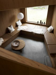 room with brown leather and oak wood paneling