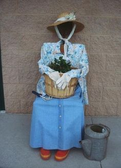 This garden gal (Dressed up Chair) will be sitting outside my shop to welcome guests to my next sale -- my new business partner of sorts.  Some of the guys in the neighboring units aren't too sure about what I'm doing -- this will seal the deal!