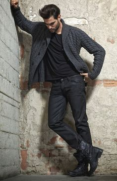 Shawl collar, cable knit grey cardigan; black T-shirt; dark wash jeans; black boots. (I actually own/wear this combo all the time.) :-)